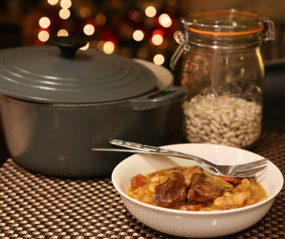 Cider braised pork cheeks and beans